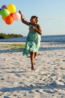 Happy Girl With Balloons Stock Photo