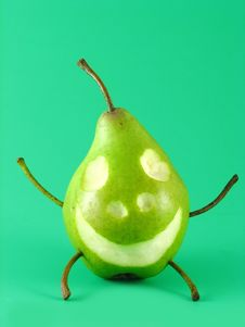 Cheerful Pear On Green Royalty Free Stock Image