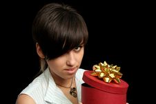 Free The Young Girl Holds A Gift Royalty Free Stock Photo - 3262775