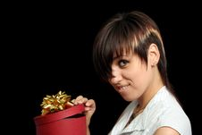 Free Girl Looks In A Box With Gift Royalty Free Stock Photography - 3262777