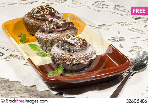 Free Diet Chocolate Cupcakes On Yeliow Rectangular Plate With Spoon Royalty Free Stock Image - 32605486