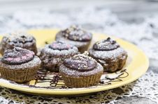 Diet Chocolate Cupcakes On Yellow Plate Royalty Free Stock Photos