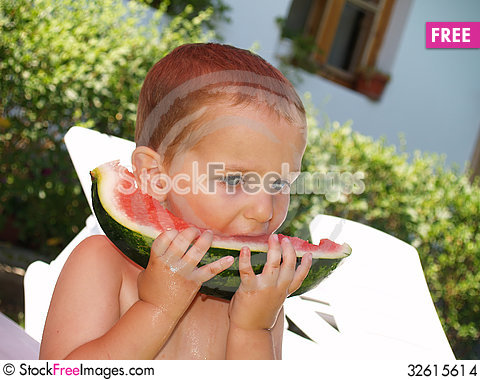 Free Baby Eat Watermelon In Garden Stock Images - 32615614