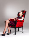 Free Woman With Fashion Hairstyle And Red Armchair Stock Photography - 32641482