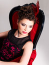 Free Woman With Fashion Hairstyle And Red Armchair Royalty Free Stock Image - 32641486