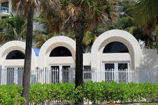 Free Tropical Palm Trees In Front Of Arched Doorways Stock Photos - 32640633