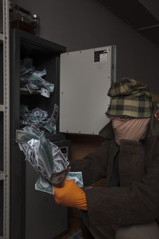 A Thief Steals Money From The Safe Stock Photography