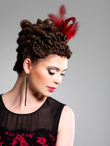 Woman With Fashion Hairstyle With Red Feather In Hairs Royalty Free Stock Photo