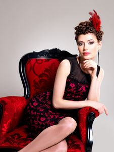Free Woman With Fashion Hairstyle And Red Armchair Stock Photo - 32641460