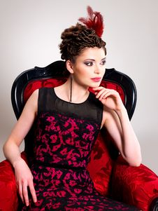Free Woman With Fashion Hairstyle And Red Armchair Stock Photography - 32641462