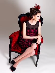 Free Woman With Fashion Hairstyle And Red Armchair Royalty Free Stock Photo - 32641475
