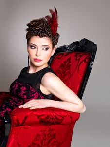 Free Woman With Fashion Hairstyle And Red Armchair Royalty Free Stock Photos - 32641478