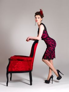 Free Woman With Fashion Hairstyle And Red Armchair Royalty Free Stock Images - 32641479
