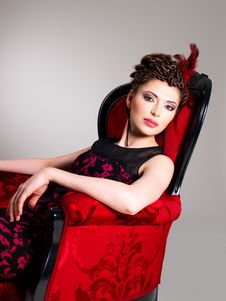 Free Woman With Fashion Hairstyle And Red Armchair Stock Photo - 32641480