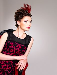 Free Woman With Fashion Hairstyle And Red Armchair Royalty Free Stock Photo - 32641485