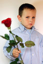 Free Shy Boy Giving Flowers Royalty Free Stock Photography - 3275827