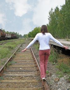 Free Girl Goes On Rail Stock Images - 3270384