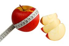 Apple And Measuring Tape Stock Images