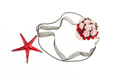 Free Red Crystal Star Fish Necklace With Bush Of Roses Stock Photo - 32742110