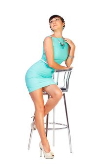 Free Woman Brunette In Turquoise Dress Sits On Chair Royalty Free Stock Image - 32746646