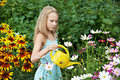Free Little Girl Watering Flowers Royalty Free Stock Images - 32794389