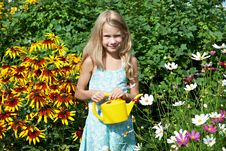 Free Little Girl With Watering Can Near Flowers Royalty Free Stock Images - 32794539