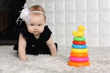 Little Cute Baby Creeps On Soft Carpet Stock Photography