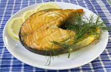 Free Fried Salmon On A Plate With Lemon And Dill On A Blue Checkered Table Cloth Stock Photos - 32797043
