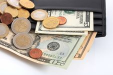 Wallet And Currencies Royalty Free Stock Photography
