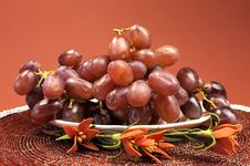 Plate Of Healthy Fruit, Red Grapes, In Red Brown Autumn Fall Setting Stock Images