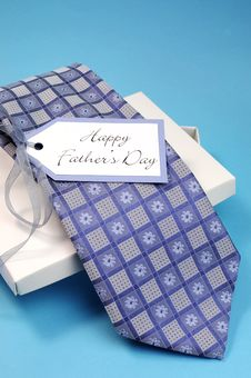 Happy Fathers Day Gift Of A Blue Pattern Check Tie - Vertical. Stock Image