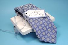 Happy Fathers Day Gift Of A Blue Pattern Check Tie Stock Photo