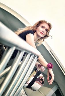 Free Portrait Of Thinking Beautiful Woman Standing On The Stairs Stock Image - 32824811
