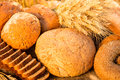 Free Bread And Wheat On The Wooden Table Royalty Free Stock Images - 32835799