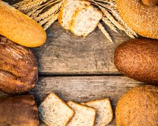 Free Homemade Bread And Wheat On The Wooden Table Royalty Free Stock Photos - 32835828