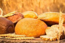 Free Homemade Bread And Wheat On The Wooden Table Royalty Free Stock Images - 32835839