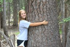 Free Athletic Teen Hugging Tree Royalty Free Stock Images - 32875529