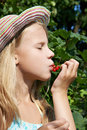 Free Girl Eats Red Currant In The Garden Stock Image - 32881961