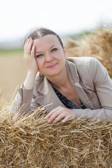 Free Portrait Of A Girl On The Stacks Of Wheat Stock Images - 32884274