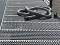 Free Gray Hose On Grating Stock Photography - 3298272