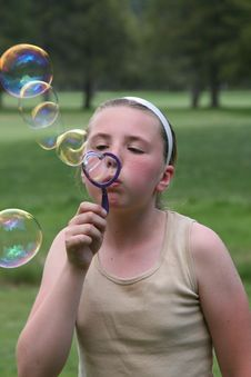 Free Girl Blowing Bubbles Stock Photography - 3292912