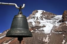Old Bell With A Mountain. Stock Photo