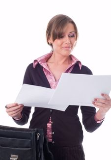 The Girl Looks Through Papers Stock Photos