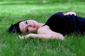 Free Brunette Lying On A Grass Stock Photos - 32999763