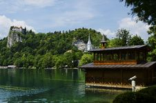 Free Beautiful Boathouse On Bled Lake With Bled Castle In The Background Stock Photography - 32999292