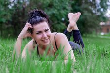 Free Brunette Smiling On A Grass Stock Photography - 32999732