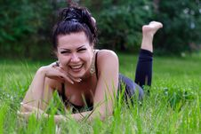 Free Brunette Laughing On A Grass Royalty Free Stock Photography - 32999747