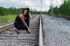 Free Young Woman Sitting On A Railroad Royalty Free Stock Photo - 32999855
