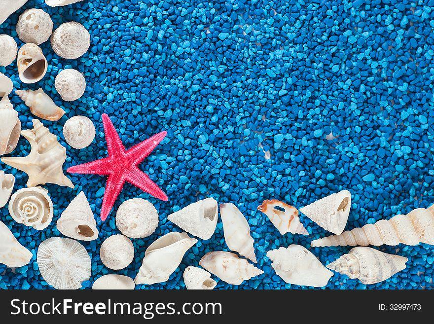 Star-fish and seashells on sand
