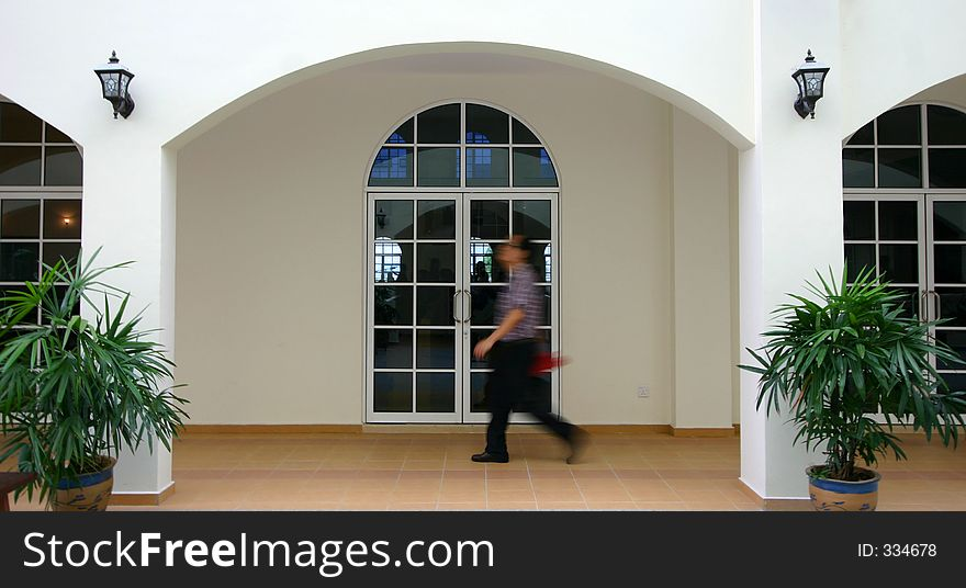 Man walking past arches